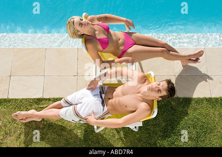 Couple sunbathing - Stock Photo