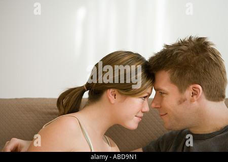 Couple touching foreheads - Stock Photo