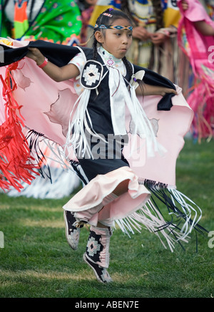 A Native American in full regalia takes part in a fancy dance contest during a powwow in northern Utah - Stock Photo