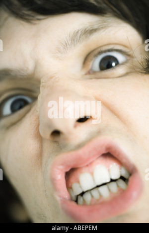 Teen boy making angry face, extreme close-up - Stockfoto