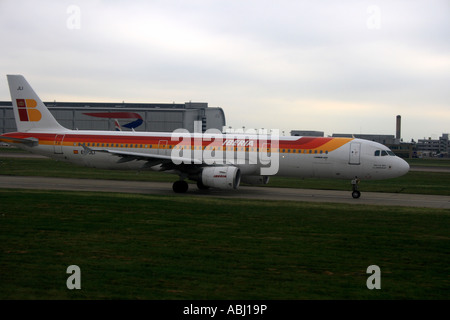 Iberia plane landing in London Heathrow airport, Great Britain, Europe. Photo by Willy Matheisl - Stock Photo