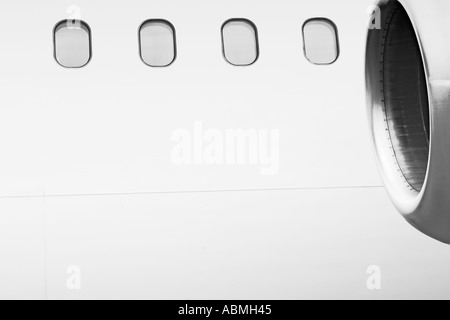 Windows And Engine Of Commercial Airliner From Outside - Stock Photo