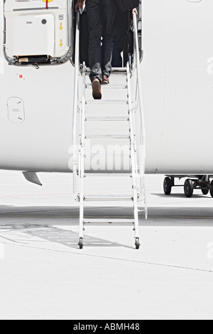 Passenger Boarding Airliner - Stock Photo