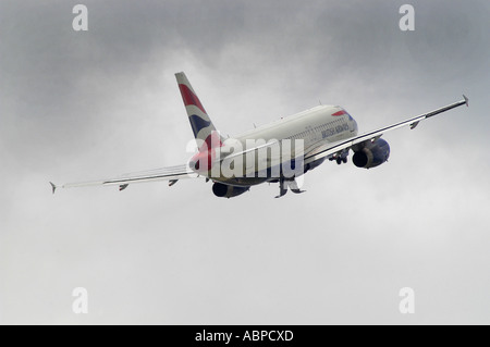 A British Airways airliner taking off from Heathrow Airport London Picture by Andrew Hasson May 18th 2006 - Stock Photo