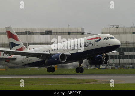 A British Airways airliner landing at Heathrow Airport London Picture by Andrew Hasson May 18th 2006 - Stock Photo