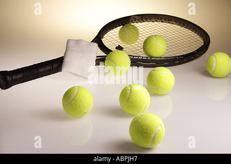VDA78898 Tennis balls eight green color with tennis racket and wrist band - Stock Photo