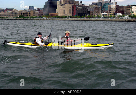 NYS Governor George Pataki R joins about 100 other kayakers on July 15 2004 for the final leg of the 10 Day Great - Stock Photo