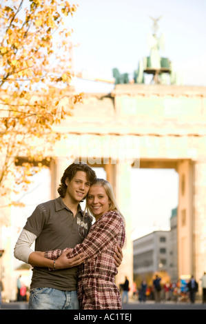 Couple in street, embracing - Stock Photo