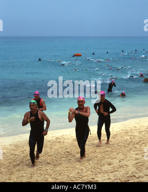 Swimmers run out of  the ocean at the Miyako International Triathlon 2006 - Stock Photo