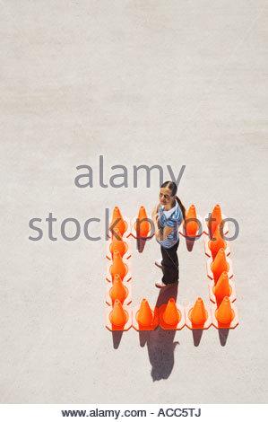 Woman inside box of traffic cones - Stock Photo