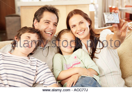 A family taking a picture of themselves - Stock Photo
