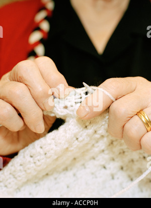Close-up on womans hands knitting. - Stock Photo