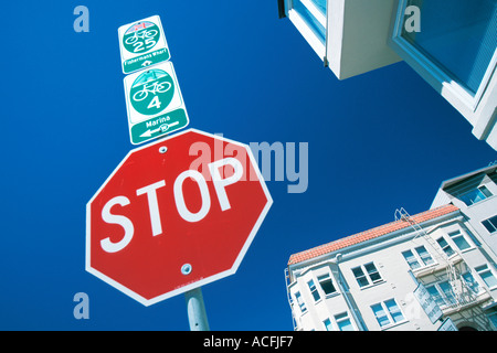 Stop sign with bicycle route signs San Francisco California United States - Stock Photo