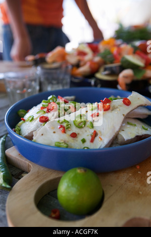 A plate with marinated fish. - Stock Photo