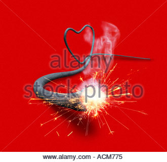 Lit fuse in a heart shape - Stock Photo