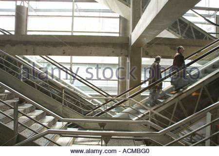 two businessmen going up a stairs in a station - Stock Photo