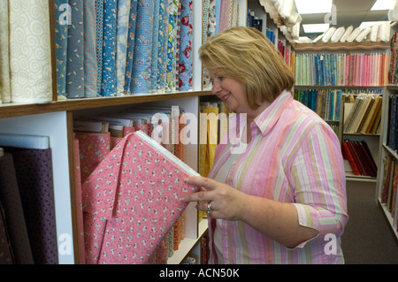 Woman shopping in a fabric store - Stock Photo