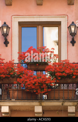 Balcony doors and window box in the medieval town of montisi tuscany stock photo royalty free - Care geraniums flourishing balcony porch ...