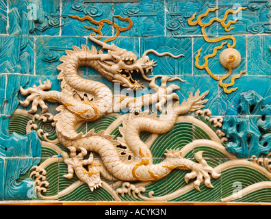 Detail of ornate ceramic dragon on Nine Dragons Screen wall at Beihai Park Beijing 2007 - Stock Photo