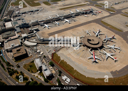 London Gatwick Airport aerial view showing the south terminal and its sattelite arm with aircraft loading and unloading. - Stock Photo