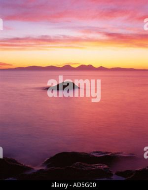 The Paps of Jura seen from the Kintyre Peninsular at sunset, Argyll and Bute, Scotland, UK - Stock Photo