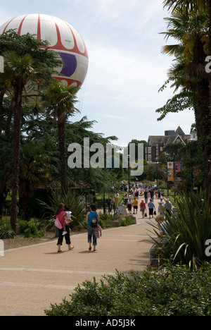 Two young women, mother and child, daughter, strolling through Bournemouth Pleasure Gardens, Dorset, England, UK - Stock Photo