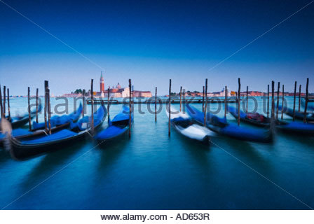 Gondolas moored up with the cathedral of San Giorgio Maggiore in the distance, Venice, Italy - Stock Photo