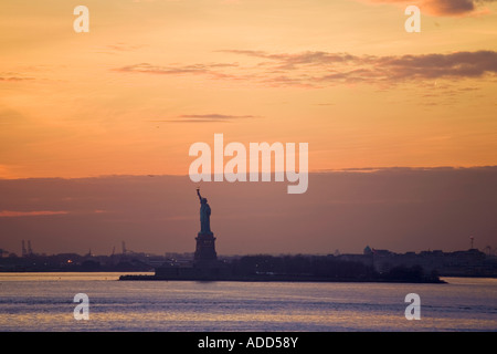 Statue of Liberty seen from Battery Park New York City USA - Stock Photo