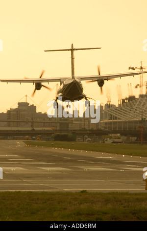 Regional turboprop airliner landing - Stock Photo