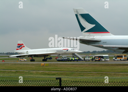 Cathay Pacific Boeing 747 Passes Concorde at Manchester Farewell 22 October 2003 England United kingdom UK - Stock Photo