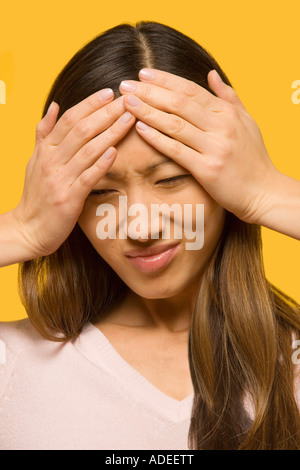 Woman with severe headache or stress. - Stock Photo