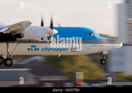 Close up of regional turboprop airplane Fokker 50 KLM about to land at London City Airport England UK - Stock Photo
