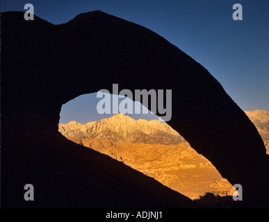 Lone Pine Peak as seen through silhouetted arch Alabama Hills California - Stock Photo
