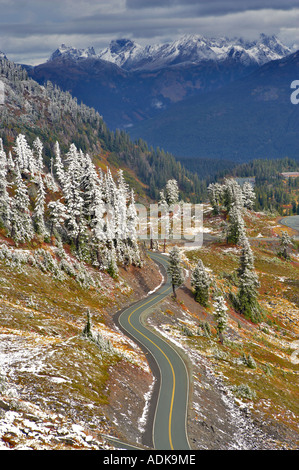 Road in Heather Meadows and Nooksack Range with first snow of season Washington - Stock Photo