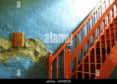Rred staircase against blue wall in Baba Nyonya house, Melaka, Malaysia - Stock Photo