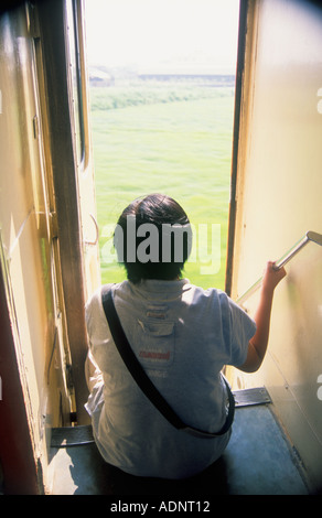 Person Riding On Train Looking Out Taiwan China - Stock Photo