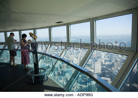 Tourists in the sky pod the world s highest observation deck on the CN Tower in Toronto Ontario Canada - Stockfoto
