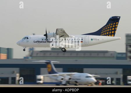 Lufthansa Regional aircrafts - Stock Photo