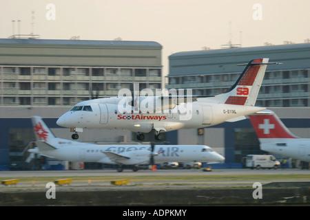 Scot Airways Dornier 328 landing at London City Airport, England, UK. - Stock Photo