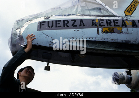 Visitor to the Duxford air museum, looking over a captured Argentine Air Force Pucara aircraft, Cambridgeshire, - Stock Photo