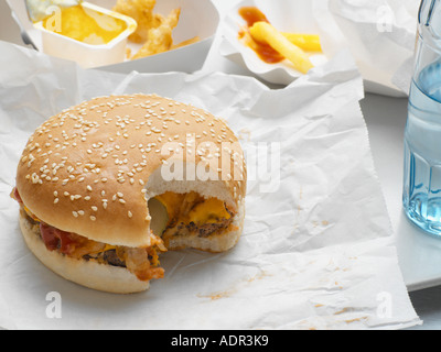 Cheeseburger with missing bite - Stock Photo