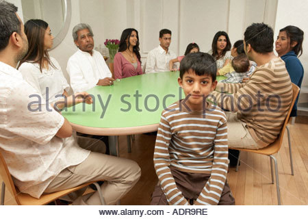 Large Family At Dining Table   Stock Photo