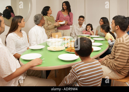 ... Large Family At Dining Table   Stock Photo