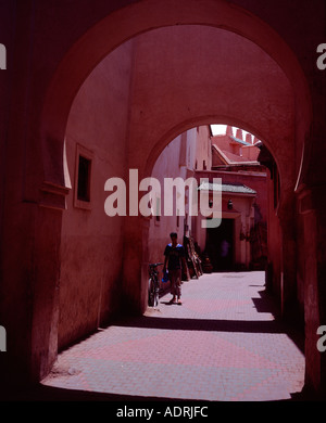Archway over street in the Medina Marrakech Morocco - Stock Photo