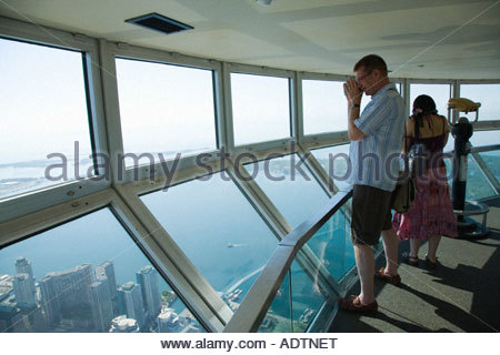 Tourists in the sky pod the world s highest observation deck on the CN Tower in Toronto Ontario Canada - Stock Photo