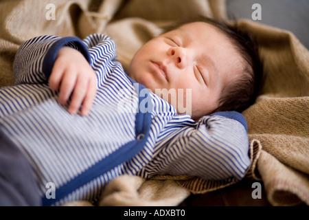 Sleeping baby boy - Stock Photo