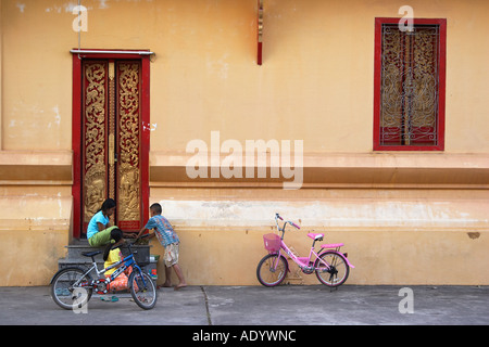 Children Playing Outside Temple - Stock Photo