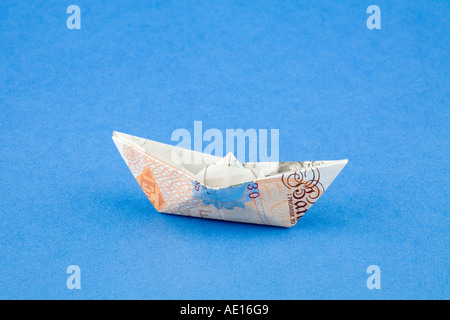 10 20 50 Origami Boats Made From British Banknotes Stock Photo