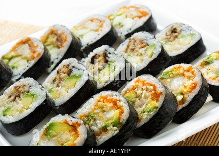 A Japanese dish consisting of sushi rolls on a serving plate. - Stock Photo