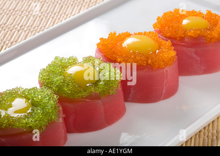 A Japanese dish on a plate consisting of 4 pieces of sushi. - Stock Photo